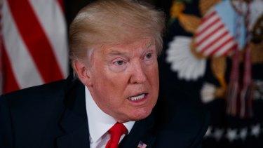 US President Donald Trump warns North Korea during a press conference at the Trump National Golf Club.