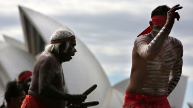 Dancers from the Koomurri perform on Sydney Harbour to promote Australia Day festivities.