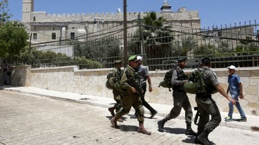 Israeli soldiers outside the site known to Muslims as the Ibrahimi Mosque and to Jews as the Cave of the Patriarchs.