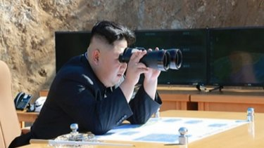 North Korean news shows what was said to be North Korean leader Kim Jong-un watching the launch of a Hwasong-14 ICBM.