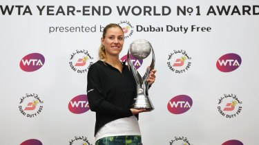 Angelique Kerber picking up her end-of-year World No.1 trophy.