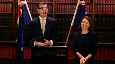 Treasurer Dominic Perrottet, with Premier Gladys Berejiklian, is spearheading the privatisation of Land and Property Information.