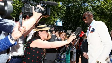 Usain Bolt meets the media during Oaks Day at Flemington.