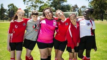 Lara (Monique Heath), Bella (Molly Broadstock), Liv (Ashleigh Marshall), Marnie (Emmanuelle Mattana), Anusha (Gemma Chua Tran), and Ruby (Celine Ajobong) in Mustangs FC.