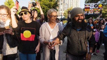 Clinton Pryor walking into The Block in Redfern where he was greeted by the community.