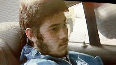 Sevdet Besim after being taken into police custody.