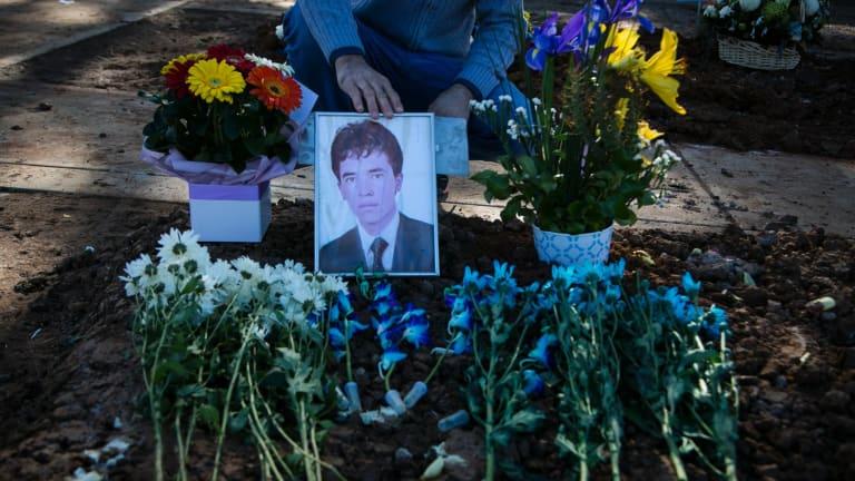At the grave of Hazara asylum seeker Mohammad Hadi,  one of a spate of suicides among Afghanistan Hazara asylum seekers in Australia.