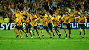 Oh what a night: the Socceroos celebrate after John Aloisi's famous penalty kicked them into a first World Cup in 32 years.