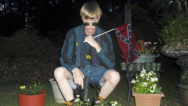 Dylann Roof, charged with carrying out the Charleston church massacre, poses with a Confederate flag and a Glock pistol in  this photo with a digital timestamp of April 27, 2015.