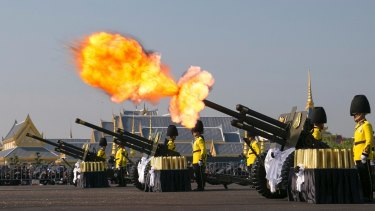 An artillery gun is fired at the funeral procession and royal cremation ceremony of late Thai King Bhumibol in Bangkok on Thursday.