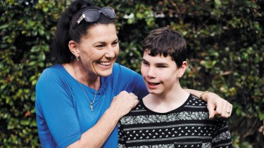 Ally McLeod with her son Connor McLeod, a 15-year-old who was born blind and convinced the Reserve Bank to introduce tactile banknotes.