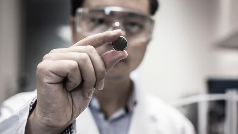 The University of Wollongong's  Shulei Chou demonstrating a sodium-ion energy battery.
