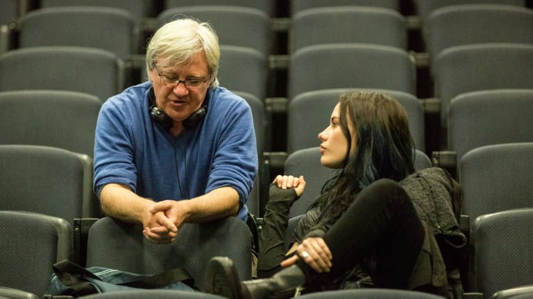 Geoffrey Wright discusses a scene with actor Lily Sullivan (Petra) on the set of the