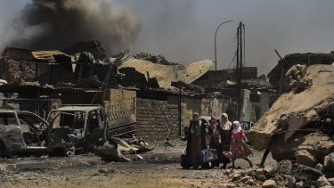 People flee the last of the Islamic State-held areas in West Mosul.