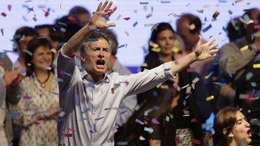 Top opposition presidential candidate and Buenos Aires Mayor Mauricio Macri dances and sings after speaking to supporters in Buenos Aires on Sunday.