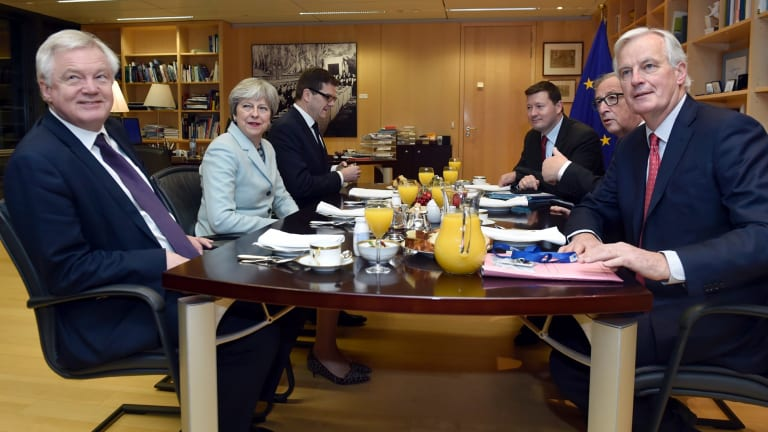 From left, Britain's Secretary of State for Exiting the European Union David Davis,  Theresa May, Jean-Claude Juncker and EU's chief Brexit negotiator Michel Barnier.
