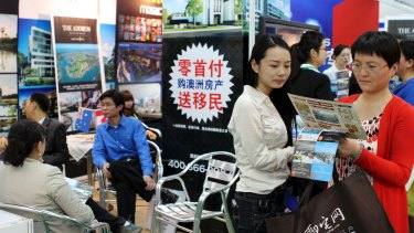 Investors crowd round an Australian booth at a property fair in Beijing.