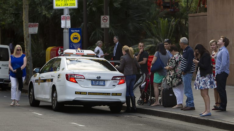 People queue for taxis at circular quay in Sydney.