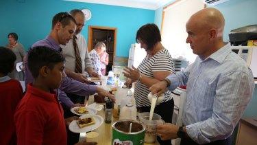 Education Minister Adrian Piccoli (right) at Walgett's breakfast club.