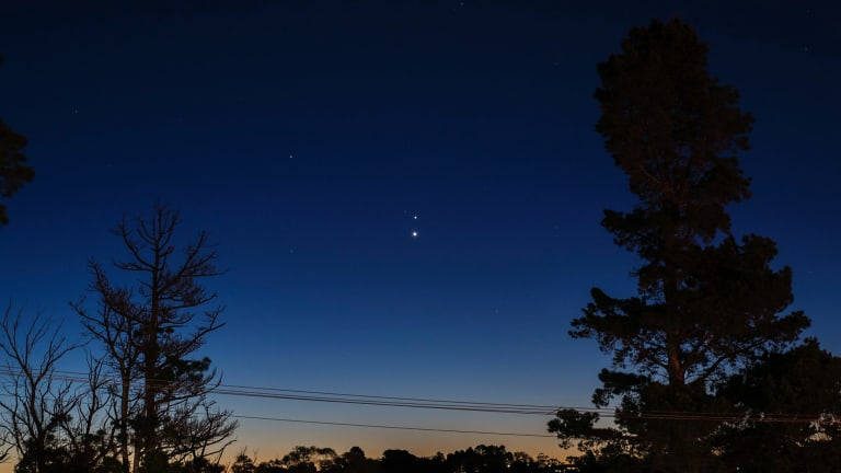 This image, taken in Brisbane in 2016, shows a Jupiter-Venus conjunction, with Venus the lower star in the centre of the image. This year's conjunction will bring the two even closer together in our sky.