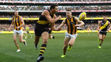 Quick give: Richmond ruckman Toby Nankervis under pressure on the boundary.