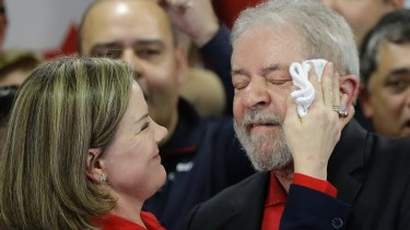 Worker's Party president, Senator Gleisi Hoffmann, wipes sweat from the face of former Brazilian president Lula in July.