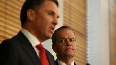 Labor's immigration spokesman Richard Marles and Opposition Leader Bill Shorten address the media on Monday.