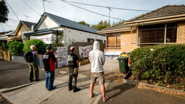 Homeless people and activists pictured in front of the Bendigo Street, Collingwood, house at the centre of a standoff with the Office of Housing.