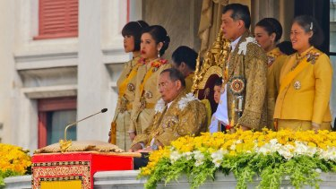 Thailand's King Bhumibol Adulyadej with his family on his 85th birthday.