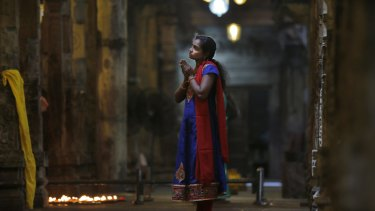 An ethnic Tamil woman prays at a Hindu temple in Colombo, Sri Lanka, on Friday.