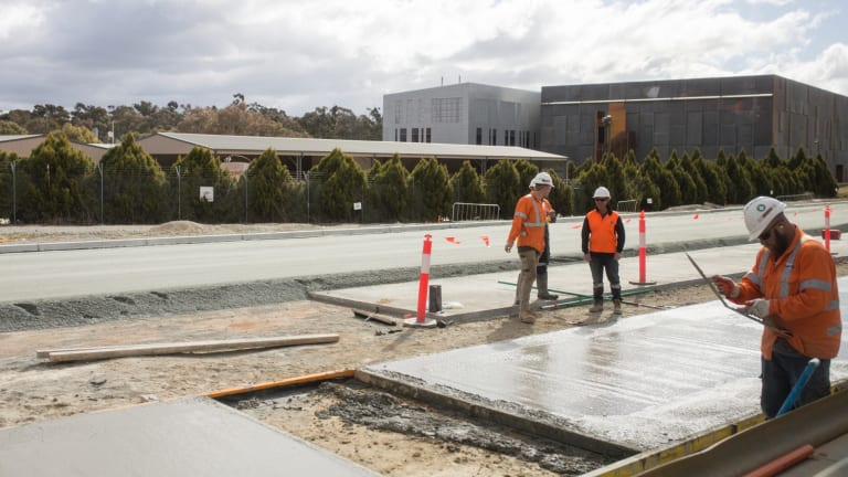 Workers laying track slab on the Gungahlin stretch of Canberra's light rail.