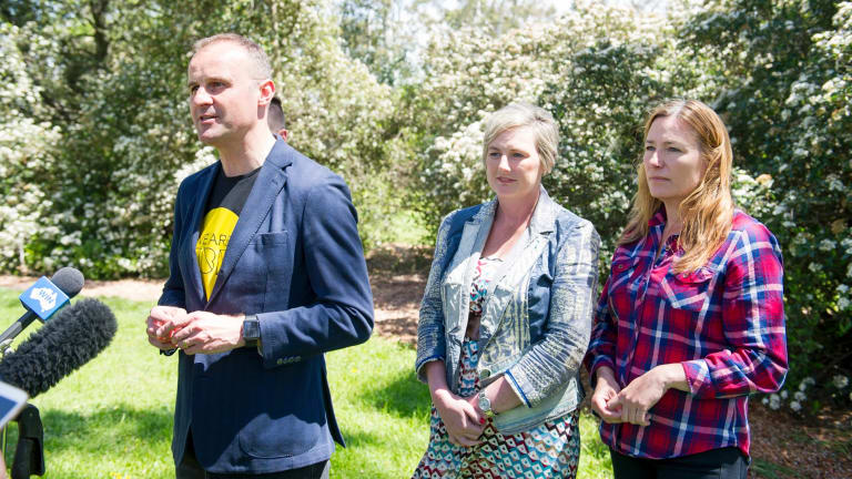 From left Chief Minister Andrew Barr, newcomer Bec Cody, and the likely deputy chief minister Yvette Berry celebrate their election win at Corroborree Park in Ainslie.