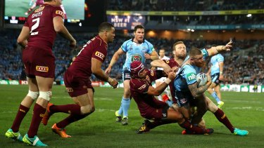 Brought down: Josh Dugan is tackled during game three.