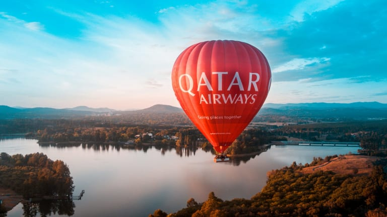 The Qatar Airways balloon, flown by Balloon Aloft Canberra, flies over Canberra.