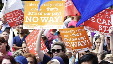 Thousands of workers vented their anger over cuts to penalty rates outside the NSW Parliament on Wednesday.