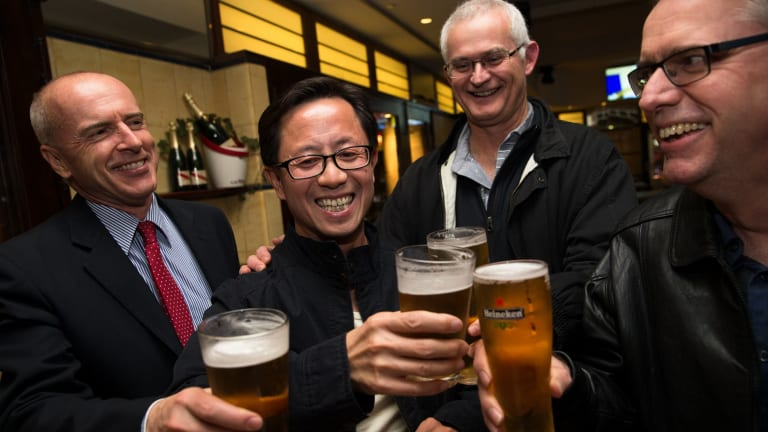 Matthew Ng celebrates his release with his lawyer, Tom Lennox (left) and friends from his days studying at the Australian Graduate School of Management, David Marquard and Ken Wagner.