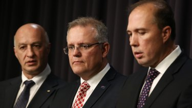 Refugee advocate Paris Aristotle, Treasurer and former immigration minister Scott Morrison, and Immigration Minister Peter Dutton