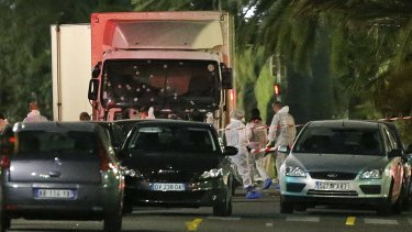 Police surround the truck that slammed into a Bastille Day crowd in Nice on Thursday.