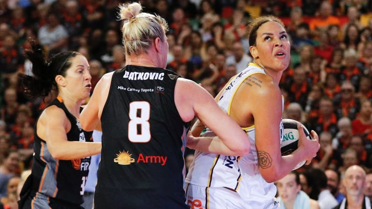 The Boomers' Liz Cambage drives to the basket against Townsville in the opening game of the grand final series.