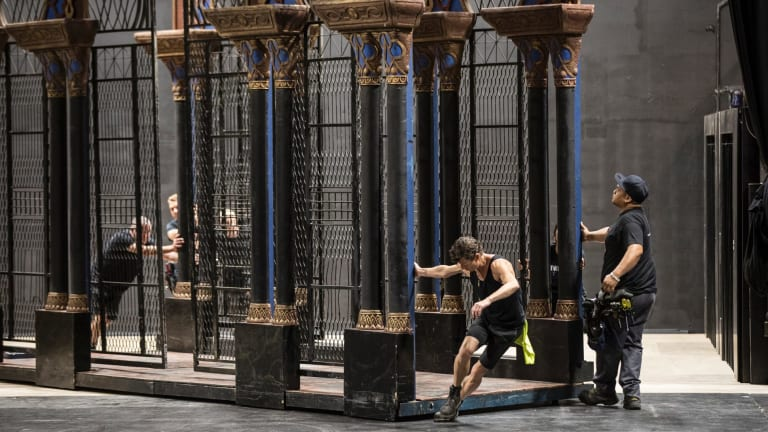 Stagehands move one of the sets from <I>La Traviata</I>.