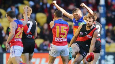 Boilover: Tom Rockliff of the Lions celebrates with Dayne Zorko and Lewis Taylor.