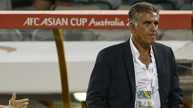 Bye, bye: Iran coach Carlos Queiroz looks angry after his team's defeat in the Asian Cup quarter-finals.
