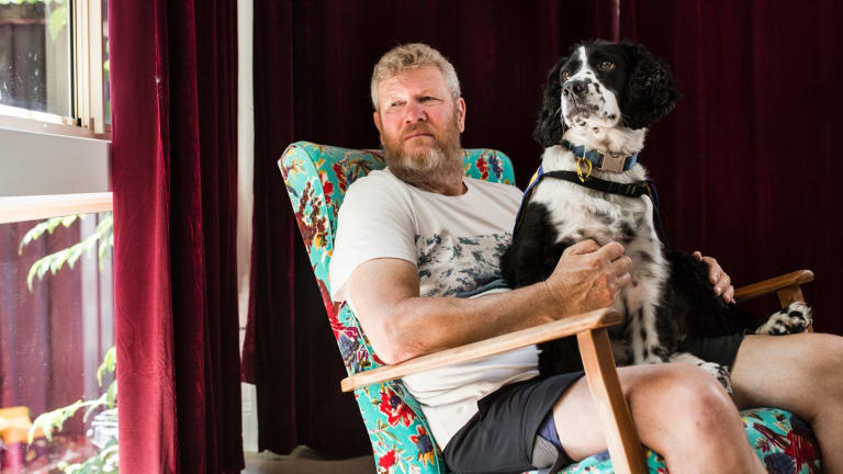Michael Brideson with his assistance dog Ted.