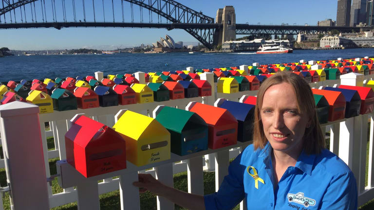 Erin Vassallo with the Fatality Free Friday letterboxes, each of which represents a death on NSW roads in 2016. Ms Vassallo's nephew died in a car crash in July 2014.
