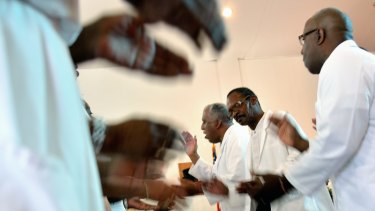 Pastor Jerry Colbert, 64, (centre), at the Hall United Methodist Church in Glen Burnie, Maryland.