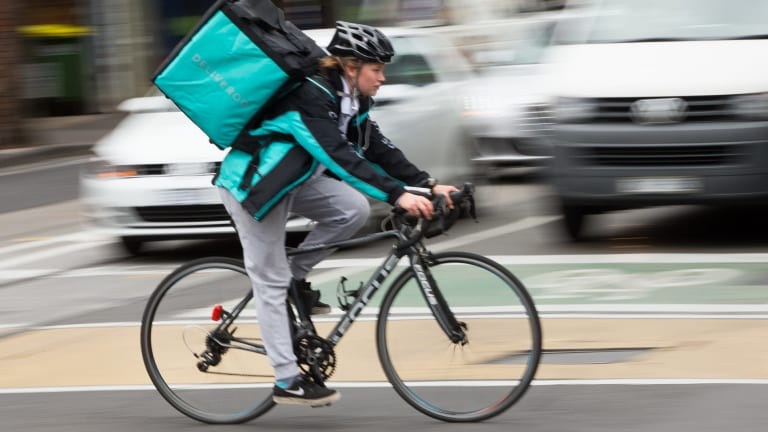 A Deliveroo driver in a previous version of the uniform.