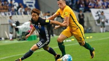 Beaten: Takuma Asano takes the ball past Brad Smith.