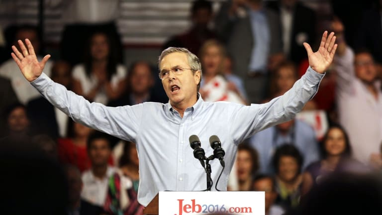 Former Florida Governor Jeb Bush waves to the crowd as he formally joins the race for president.