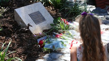 Flowers were laid in front of the memorial plaque.
