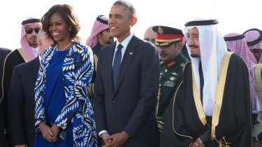Former President Barack Obama and wife Michelle with King Salman in 2015. Donald Trump criticised her bare head then; his wife Melania embraced the look on her visit.